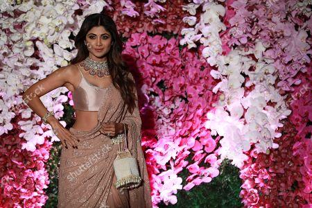 Bollywood actress Shilpa Shetty poses as she arrives to attend the wedding reception of Akash Ambani, son of Reliance Industries Chairman Mukesh Ambani, in Mumbai, India, 10 March 2019. Akash Ambani got married to Shloka Mehta on 09 March 2019.