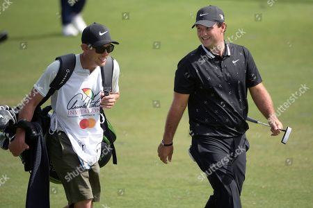 American track and field sprinter Noah Lyles trains at the National Training Center in Clermont, Florida. Patrick Reed, right, walks with his caddie after hitting from the eighth fairway during the final round of the Arnold Palmer Invitational golf tournament, in Orlando, Fla