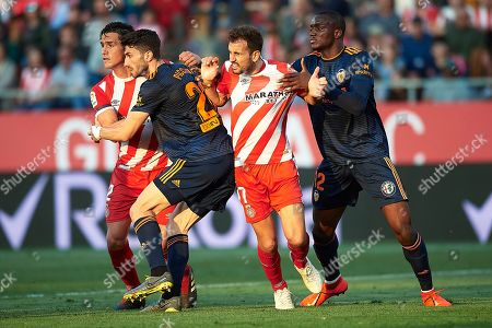 Cristhian Stuani of Girona FC and Mouctar Diakhaby of Valencia CF