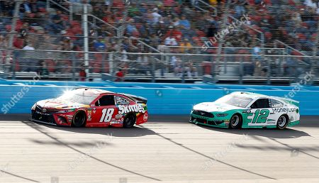 Kyle Busch (18) leads Ryan Blaney (12) through Turn 4 during the NASCAR Cup Series auto race at ISM Raceway, in Avondale, Ariz