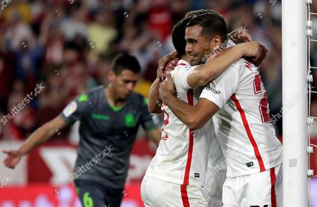 Sevilla's forward Wissam Ben Yedder (L) celebrates with his teammate defender Gabriel Mercado (R) after scoring the 5-1 during the Spanish LaLiga match between Sevilla and Real Sociedad at Ramon Sanchez Pizjuan stadium in Seville, Andalusia, Spain, 10 March 2019.