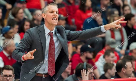 Gardner Webb coach Tim Craft sends in play against Radford during the first half of the Big South conference NCAA basketball championship game in Radford, Va