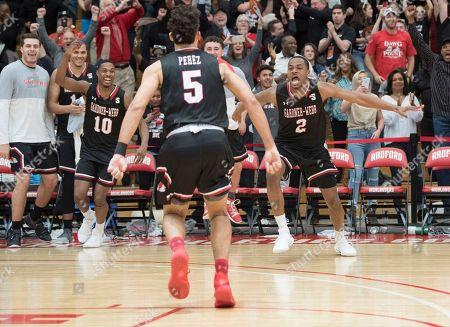 Gardner Webb guard Jose Perez (5) heads to the bench to celebrate with teammates Eric Jamison Jr. (2) and Nate Johnson (10) during the second half of the Big South conference NCAA basketball championship game in Radford, Va