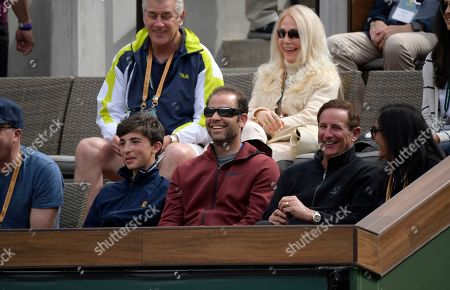 Former professional tennis player Pete Sampras, below center, looks on as Roger Federer, of Switzerland, faces Peter Gojowczyk, of Germany, at the BNP Paribas Open tennis tournament, in Indian Wells, Calif