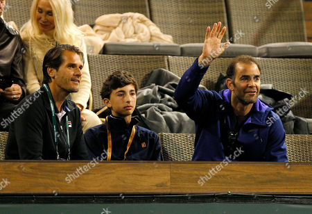 Pete Sampras waves next to his son and tournament director Tommy Haas