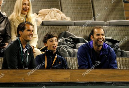 Pete Sampras smiles next to his son and tournament director Tommy Haas