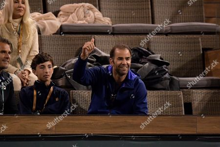 Former professional tennis player Pete Sampras reacts towards Rafael Nadal, of Spain, during a match against Jared Donaldson at the BNP Paribas Open tennis tournament, in Indian Wells, Calif