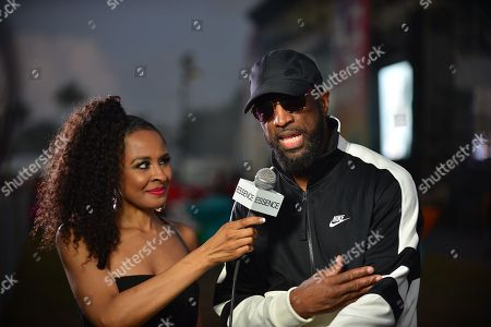 Stock Picture of Janell Snowden and Rickey Smiley backstage at the 14th Annual Jazz in the Gardens Music Festival at Hard Rock Stadium
