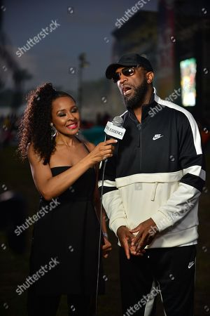 Janell Snowden and Rickey Smiley backstage at the 14th Annual Jazz in the Gardens Music Festival at Hard Rock Stadium