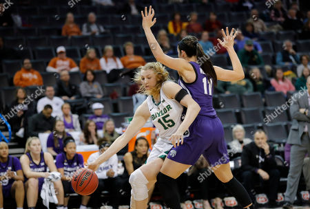 Baylor forward Lauren Cox (15) drives to the basket as Kansas State forward Peyton Williams (11) defends during the first half of an NCAA college basketball game in the Big 12 women's conference tournament in Oklahoma City