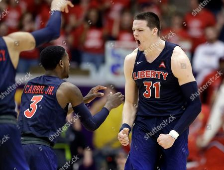 Scottie James, Lovell Cabbil Jr. Liberty forward Scottie James (31) celebrates with Lovell Cabbil Jr. (3) after James made a free throw late in the second half of the Atlantic Sun NCAA college basketball tournament championship game against Lipscomb, in Nashville, Tenn. Liberty won 74-68