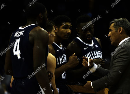 Newark, New Jersey, U.S. - Villanova Wildcats head coach Jay Wright give instructions to his team during a time out in the first half during the game between the Villanova Wildcats and the Seton Hall Pirates at the Prudential Center in Newark, New Jersey. Seton Hall upsets Villa-75