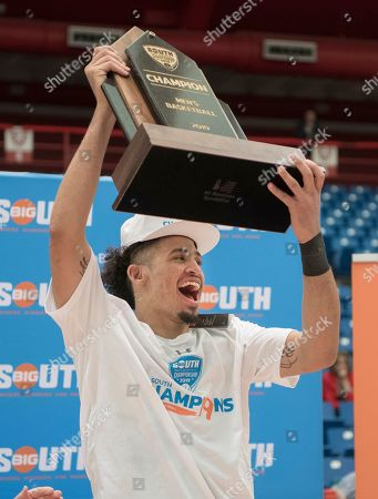 Gardner Webb guard Jose Perez (5) celebrates with the trophy after defeating Radford in the Big South conference NCAA basketball championship game in Radford, Va