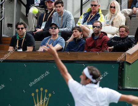 Pete Sampras watches Roger Federer (SUI) serve to Peter Gojowczyk (GER) during the BNP Paribas Open at Indian Wells Tennis Garden in Indian Wells, California