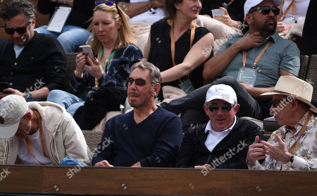 Stock Photo of 10 March, Oracle founder Larry Ellison watches Roger Federer in action against Peter Gojowczyk during the BNP Paribas Open at Indian Wells Tennis Garden in Indian Wells, California John Green/CSM