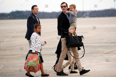 Arabella Kushner, Theodore Kushner, Jared Kushner. White House senior adviser Jared Kushner holds his son Theodore Kushner and is followed by his daughter Arabella Kushner as they walk across the tarmac after arriving on Air Force One, at Andrews Air Force Base, Md. The family was traveling to Washington from Palm Beach, Fla