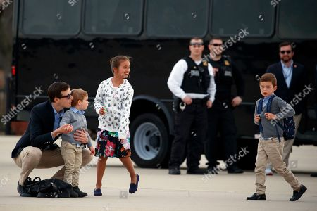 Arabella Kushner, Theodore Kushner, Jared Kushner, Joseph Kushner. From left, White House senior adviser Jared Kushner holds his son Theodore Kushner, with his daughter Arabella Kushner and son Joseph Kushner on the tarmac as they arrive, at Andrews Air Force Base, Md., en route to Washington as they return from Palm Beach, Fla
