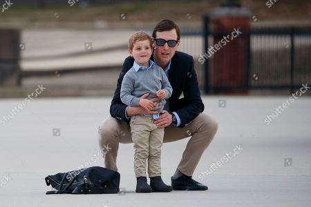 Theodore Kushner, Jared Kushner. White House senior adviser Jared Kushner holds his son Theodore Kushner as they watch Marine One depart, from Andrews Air Force Base, Md., while they were en route to Washington, with President Donald Trump, first lady Melania Trump and Barron Trump aboard