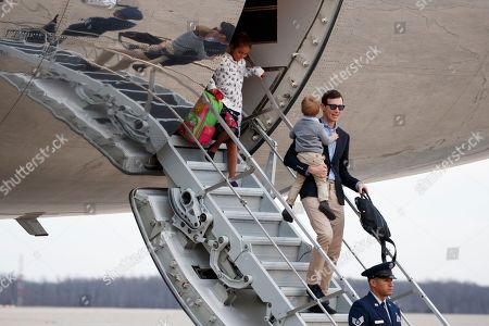 Stock Picture of Arabella Kushner, Theodore Kushner, Jared Kushner. White House senior adviser Jared Kushner holds his son Theodore Kushner and is followed by his daughter Arabella Kushner as they arrive on Air Force One, at Andrews Air Force Base, Md., en route to Washington as they return from Palm Beach, Fla