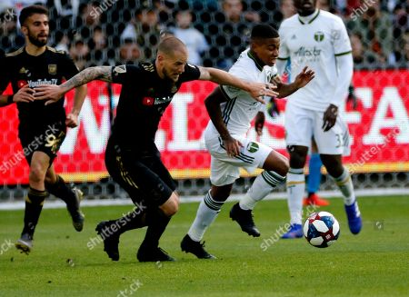 Los Angeles FC defender Jordan Harvey (2) and Portland Timbers forward Andy Polo (11) of Peru, vie for the ball during an MLS soccer match between Los Angeles FC and Portland Timbers in Los Angeles, . The Los Angeles FC won 4-1