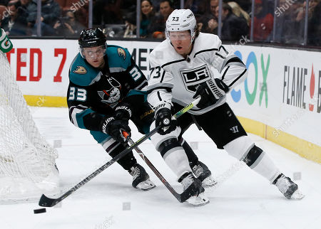 Los Angeles Kings right wing Tyler Toffoli, right, controls the puck with Anaheim Ducks right wing Jakob Silfverberg, left, of Sweden, trailing during the second period of an NHL hockey game in Anaheim, Calif