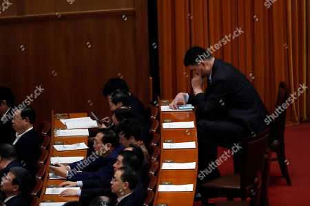 Former NBA player Yao Ming attends the 4th plenary meeting of the Second Session of the 13th Chinese People's Political Consultative Conference (CPPCC) National Committee at the Great Hall of the People (GHOP) in Beijing, China, 11 March 2019. The CPPCC is the top advisory body of the Chinese political system and runs alongside the annual plenary meetings of the 13th National People's Congress (NPC), together known as 'Lianghui' or 'Two Meetings'.