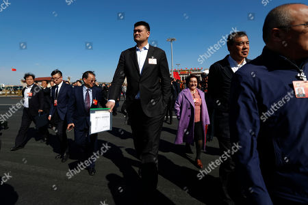 Former NBA player Yao Ming (C) arrives for the 4th plenary meeting of the Second Session of the 13th Chinese People's Political Consultative Conference (CPPCC) National Committee at the Great Hall of the People (GHOP) in Beijing, China, 11 March 2019. The CPPCC is the top advisory body of the Chinese political system and runs alongside the annual plenary meetings of the 13th National People's Congress (NPC), together known as 'Lianghui' or 'Two Meetings'.