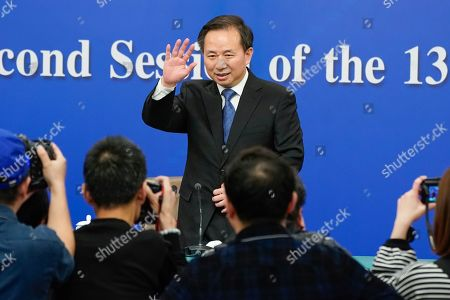 China's Minister of Ecology and Environment Li Ganjie arrives for a press conference on the sidelines of the second session of the 13th National People's Congress (NPC) in Beijing, China, 11 March 2019.