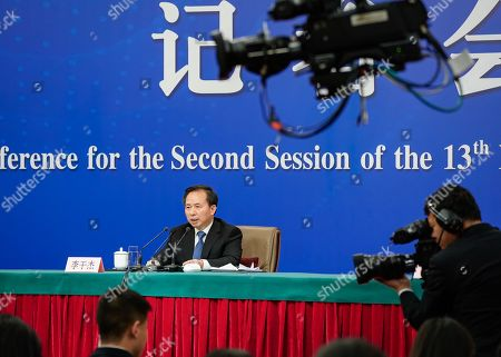 China's Minister of Ecology and Environment Li Ganjie speaks during a press conference on the sidelines of the second session of the 13th National People's Congress (NPC) in Beijing, China, 11 March 2019.