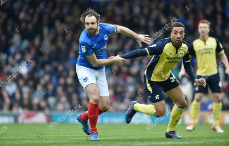 Brett Pitman of Portsmouth tussles with James Perch of Scunthorpe during the League One match between Portsmouth and Scunthorpe United at Fratton Park Portsmouth . 16 March 2019