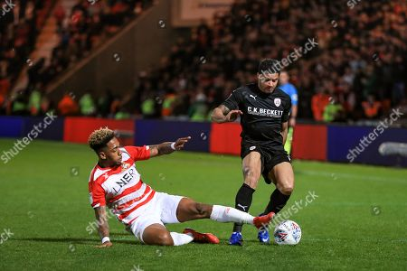 15th March 2019, Keepmoat Stadium, Doncaster, England; Sky Bet League One, Doncaster Rovers vs Barnsley ; Zeki Fryers (03) of Barnsley and Mallik Wilks (07) of Doncasterchallenge for the ball Credit: John Hobson/News Images English Football League images are subject to DataCo Licence