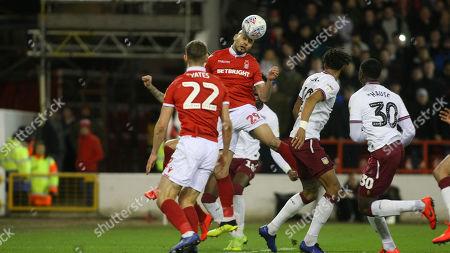 Yohan Benalouane heads the ball back across goal for Forest.