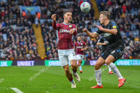 16th March 2019, Villa Park, Birmingham, England ; Sky Bet Championship, Aston Villa v Middlesbrough : Jack Grealish (10) of Aston Villa heads the ball under pressure from Dael Fry (20) of Middlesbrough  Credit: Gareth Dalley/News Images English Football League images are subject to DataCo Licence