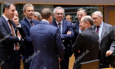 (L-R)  Belgian Finance Minister Johan Van Overtveldt, Austrian Finance Minister Hartwig Loeger, Finland's Finance Minister Petteri Orpo (back to camera), Luxembourg's Finance Minister Pierre Gramegna, Andrej Bertoncelj, the Slovenian Finance Minister and German Minister of Finance Olaf Scholz chat during the Eurogroup Finance Ministers' meeting in Brussels, Belgium, 11 March 2019. According to the agenda of the European Commission the Eurogroup will be informed on the main findings of the 2nd enhanced surveillance mission to Greece and will discuss the housing markets in the eurozone. Others are not identified.