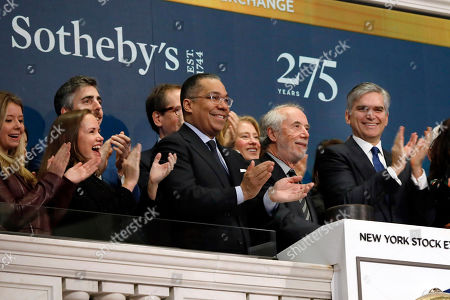 Domenico De Sole, Tad Smith. Sotheby's Chairman Domenico De Sole, second from right, is applauded by CEO Tad Smith, right, and others as he rings the New York Stock Exchange opening bell, to celebrate the company's 275th anniversary