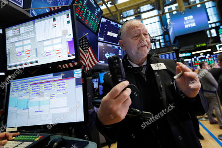 Trader Robert Moran works on the floor of the New York Stock Exchange, . Stocks are opening broadly higher on Wall Street, although a sharp drop in Boeing is pushing the Dow Jones Industrial Average lower