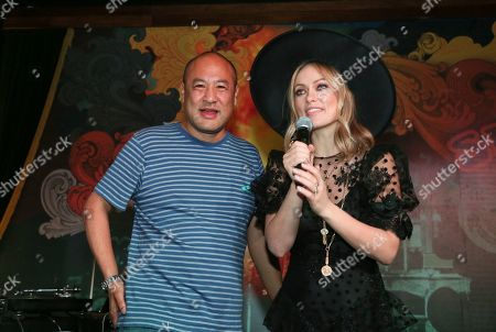 """Olivia Wilde, Dan the Automator. Olivia Wilde, right, and Dan the Automator greet the crowd during the """"Booksmart"""" world premiere after-party at Speakeasy during the South by Southwest Film Festival early, in Austin, Texas"""