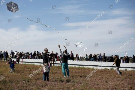 People participate in festivities for Clean Monday and fly their kites near the Stavros Niarchos Foundation Cultural Center in Athens, Greece, 11 March 2019. This festive day marks the beginning of Lent that lasts until Easter.