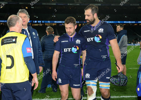 Greig Laidlaw and Josh Strauss (R) - Scotland players leave the field arm in arm following a 38-38 draw with England.