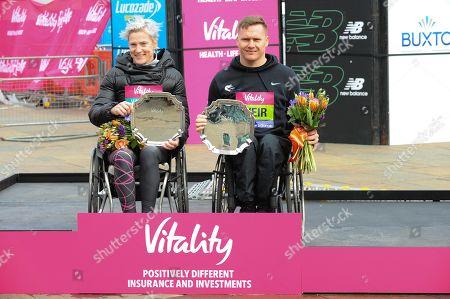 Margaret Van Den Broek and David Weir are seen posing with their awards