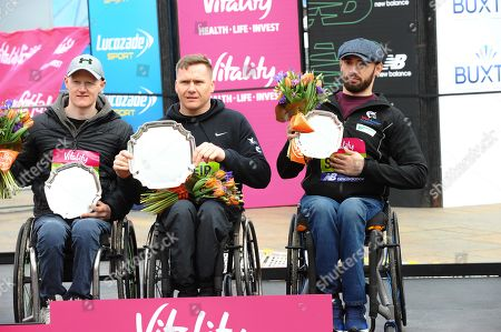 David Weir, Simon Lawson and John Boy Smith are seen posing with their awards