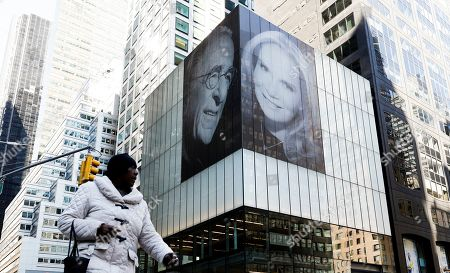 A view of giant images of real estate developer Harry Macklowe and his new wife, Patricia Landeau, on the side of 432 Park Avenue in New York, New York, USA, 11 March 2019.  The pictures of Macklowe and his new wife appear on the side of a building which was the location of a disputed apartment purchase that figured into a contentious divorce proceeding with his now ex-wife Linda Macklowe.
