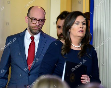 Stock Picture of Office of Management and Budget (OMB) Acting Director Russell Vought, left, follows White House Press Secretary Sarah Huckabee Sanders, right, to briefs the media in the White House Brady Press Briefing Room
