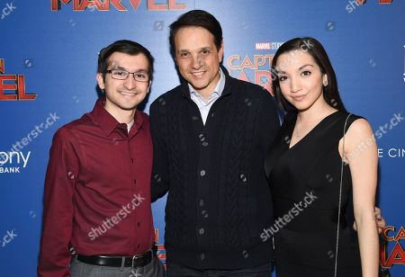 "Daniel Macchio, Ralph Macchio, Julia Macchio. Actor Ralph Macchio, center, poses with his children Daniel Macchio and Julia Macchio at a special screening of ""Captain Marvel"", hosted by The Cinema Society, at the Henry R. Luce Auditorium, in New York"