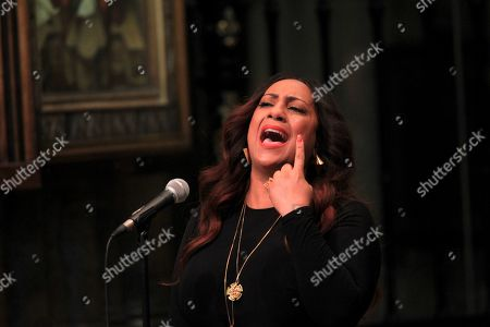 Stock Image of Lurine Cato and the B Positive Coir sing 'Rise Up'.