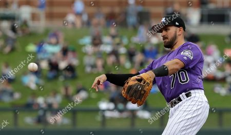 Colorado Rockies second baseman Peter Mooney in action against the Oakland Athletics in a spring training baseball game, in Scottsdale, Ariz