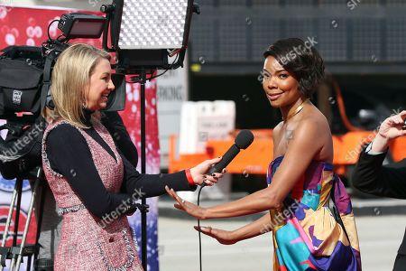 "Stephanie Stanton, Gabrielle Union. NBC News West Coast Correspondent Stephanie Stanton, left, interviews Gabrielle Union as she arrives at the ""America's Got Talent"" Season 14 Kickoff at the Pasadena City Auditorium, in Pasadena, Calif"