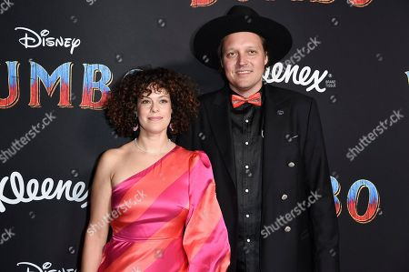"Regine Chassagne, Win Butler. Regine Chassagne, left, and Win Butler attend the LA premiere of ""Dumbo"" at the Dolby Theatre, in Los Angeles"
