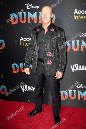 Joseph Gatt poses for the photographers as he arrives for the premiere of 'Dumbo' at the El Capitan Theater in Hollywood, California, 11 March 2019. The movie 'Dumbo' will start screening on 29 March 2019.