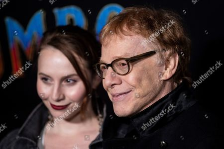 Danny Elfman (R) poses for the photographers as he arrives for the premiere of 'Dumbo' at the El Capitan Theater in Hollywood, California, 11 March 2019. The movie 'Dumbo' will start screening on 29 March 2019.